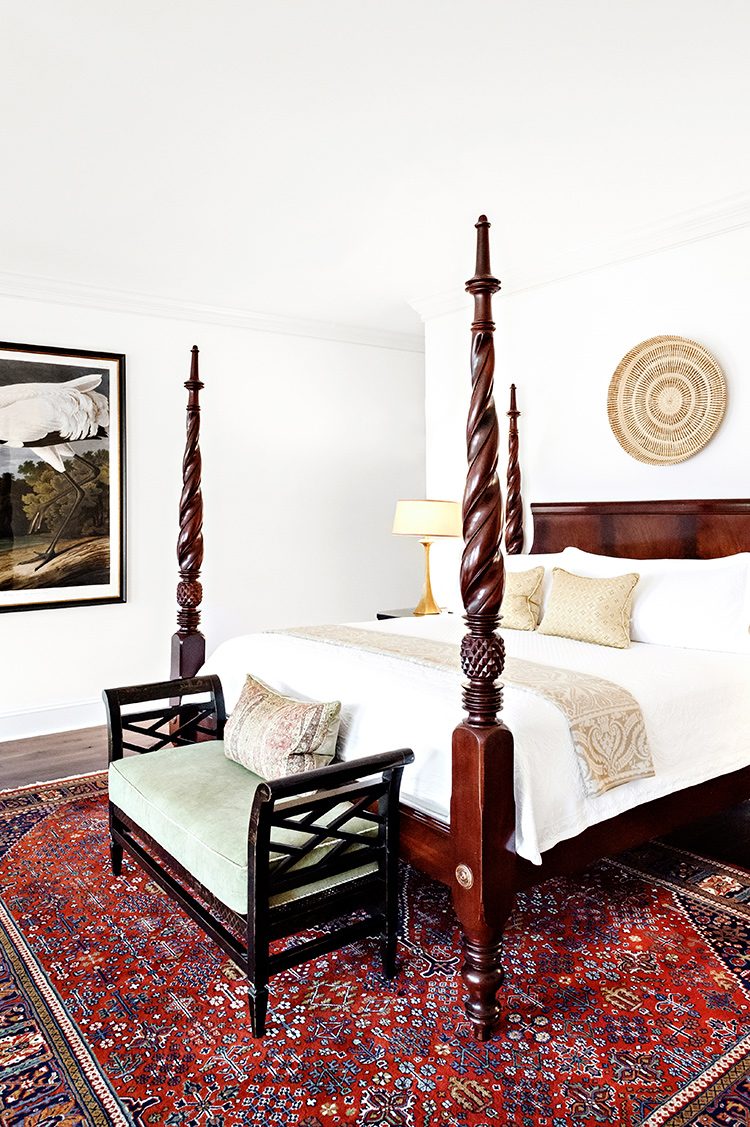 Gorgeous four-poster king bed in the Charleston City Market Hotel Suite