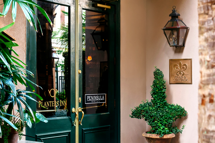 The garden entrance to Planters Inn, a luxury hotel in Charleston SC