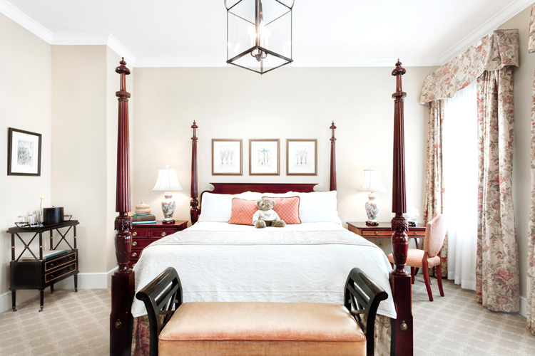 Every Planters Inn Charleston hotel room features a four poster king bed.